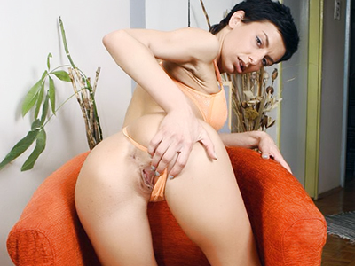 Beautiful brunette opening wide for a wet pussy inspection.